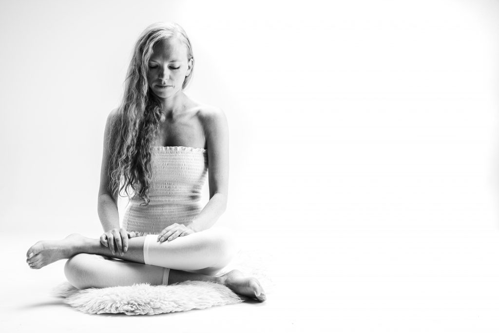 Sara G demonstrates yin yoga pose square