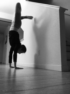 Kari demonstrating a complicated handstand to show that shoulders are not hips